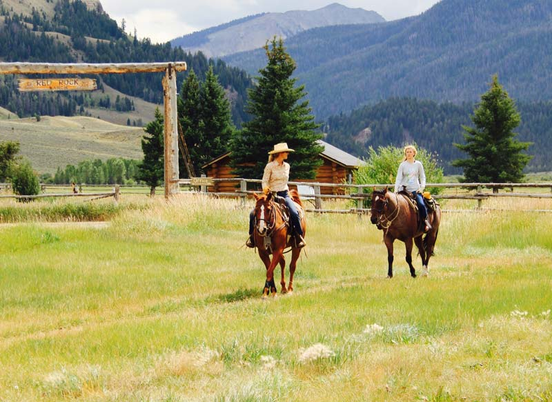 Red Rock Ranch Sign with Horseback Riders