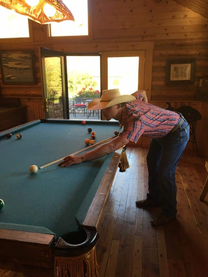 cowboy playing pool