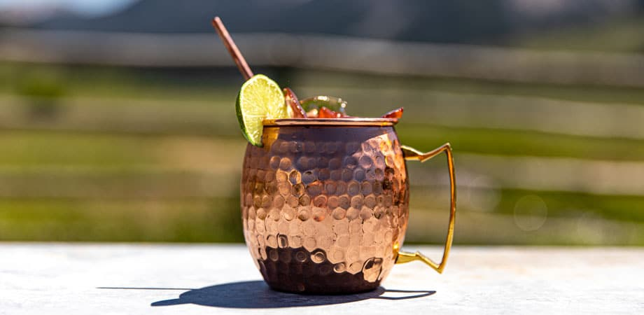 A cocktail in a metal cup